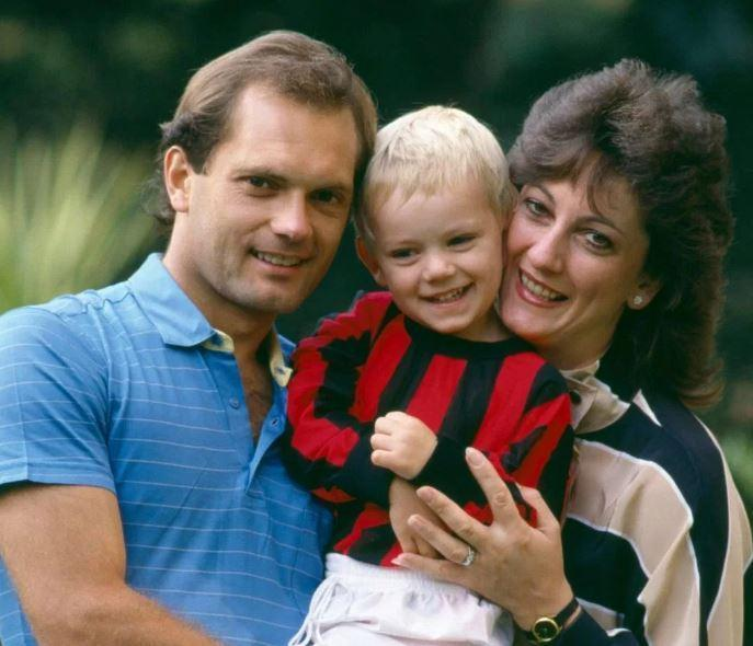 Ray Wilkins with his wife Jackie Wilkins and their child