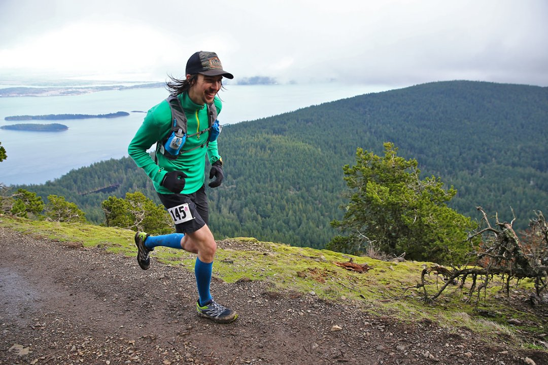 Orcas 50k - James Holk running atop Mt. Constitution - photo by Glenn Tachiyama