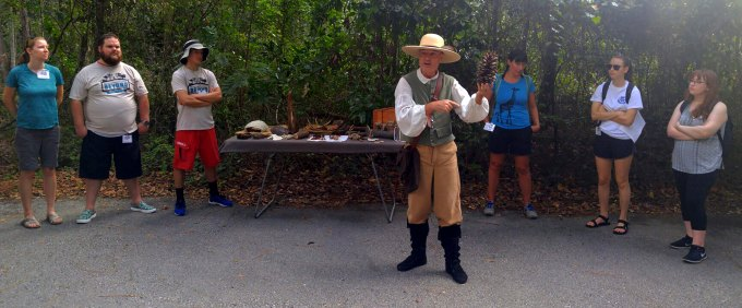 Reenactor speaking to group.