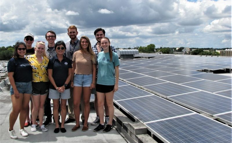 Students touring a solar facility