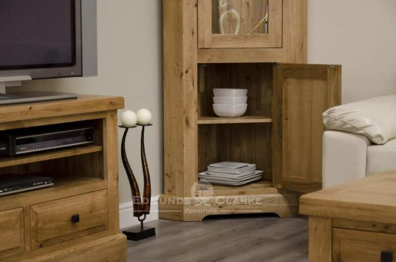 deluxe chunky rustic solid oak corner display unit with glass door to upper and two glass shelves within and one door with one shelf and choice of knobs DLXCORDU