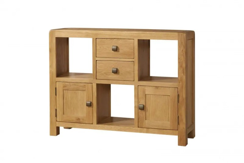 The Avon Oak Low Display Unit With Doors & Drawers Contemporary and Quirky Waxed Oak with smooth edges with square rustic knobs , 3 square spaces for ornaments and DAV08