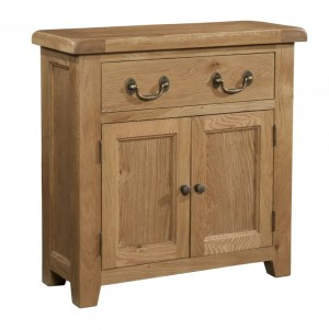 Somerset Oak Small Sideboard. 1 handy drawer, 2 door with shelf within. Chunky contemporary waxed oak .chunky top, tapered legs and dark antique brass round rustic knobs and drop down handles. SOM050