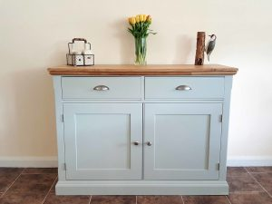 Edmunds Painted 4ft Sideboard. moulded oak top. 2 drawers and 2 doors with adjustable shelves within. image showing southwold sky with chrome cup handles and knobs. choice of handles. EDM040