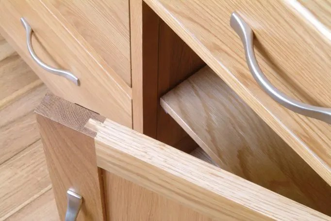 Image of Norwich Oak handle option, chrome wave style handles from edmunds & Clarke furniture