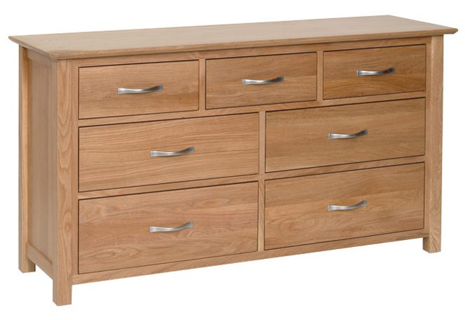 Norwich Oak 3+4 combination Chest. contemporary shaker style straight lines and shaped edges on tops. shaped chrome bar handles. 7 handy drawers. 3 small and 4 large drawers NNC90