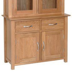 Norwich Oak 3ft Dresser Base. Contemporary shaker style with clean lines. moulded top. chrome shaped bar handle. 1 adjustable shelf inside cupboards and two handy drawers above. Sits with Norwich oak 3ft dresser top. NNS20
