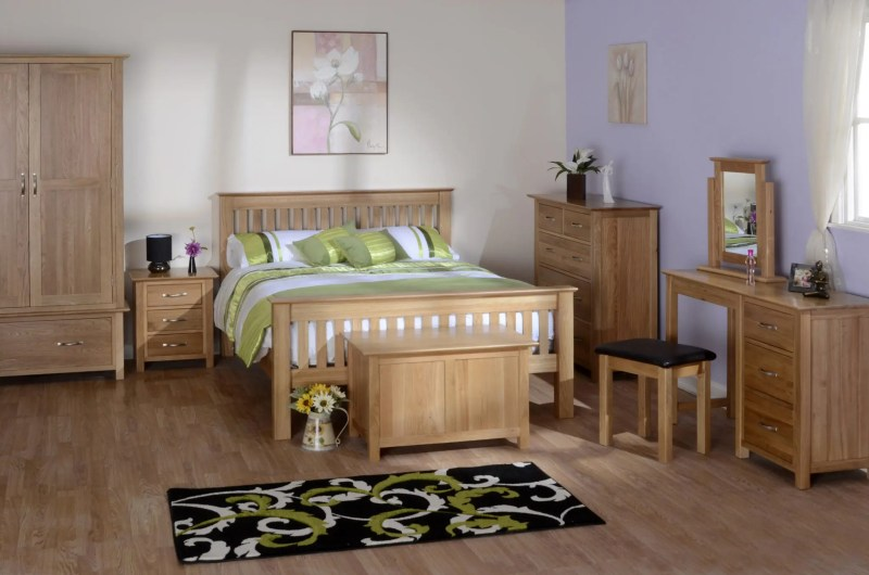 Image of room set Norwich oak bedroom furniture, dressing table, blanket box, double bed, 3 drawer bedside and 1 drawer wardrobe by edmunds & clarke furniture
