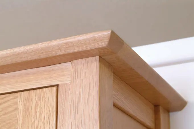 Image showing moulded top detail on a piece of Norwich Oak by Edmunds & Clarke Furniture