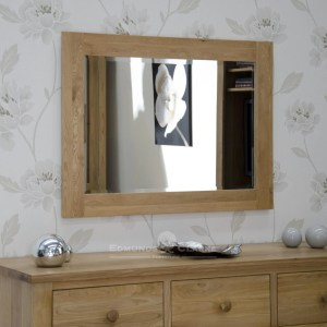 solid oak wall mirror 102cm x 72cm. bevelled glass mirror in a solid oak frame