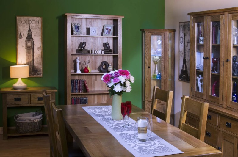 Image of Sudbury Dining room set. Rustic oak shaker style with rounded edges. image shows dining table and chairs, dresser, bookcase, corner unit and console table. available Edmunds & Clarke Furniture