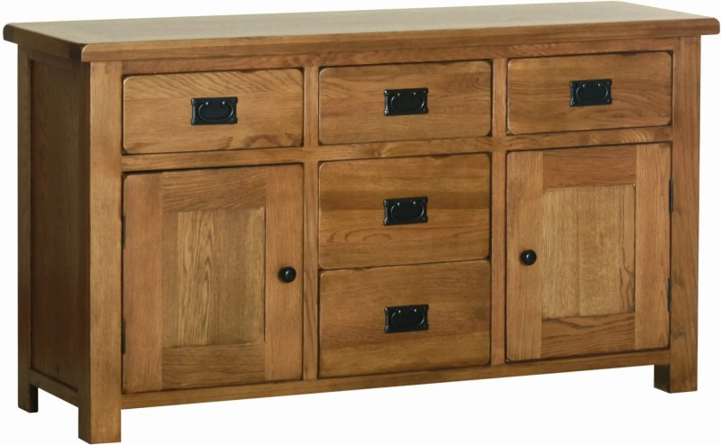 Sudbury Oak Oak 4'6 Dresser base. rustic shaker style with rounded edges. 5 handy drawers with rustic black handles, three doors with rustic black round knobs. adjustable shelf in each cupboard. Sudbury Oak offers a dresser top to match. SRS40