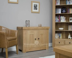 Hadleigh solid oak chunky occasional cupboard. Light lacquer with rustic square knobs. with adjustable oak shelf