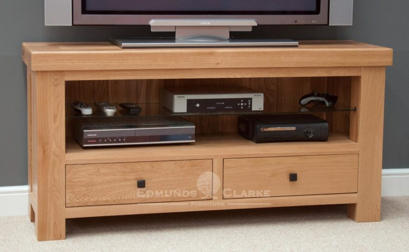 Hadleigh Solid Oak TV Unit. Chunky shaker style with toughened glass shelf and 2 handy drawers under. choice of handles available