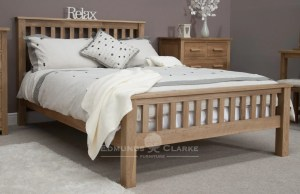 Solid oak 5ft king size slatted rail bed. vertical slats on headboard and foot end with straight oak capping
