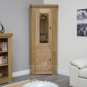 Hadleigh solid oak chunky corner display unit & light. Light lacquered finish with LEd light, Square rustic handles and adjustable glass shelves in the top part.