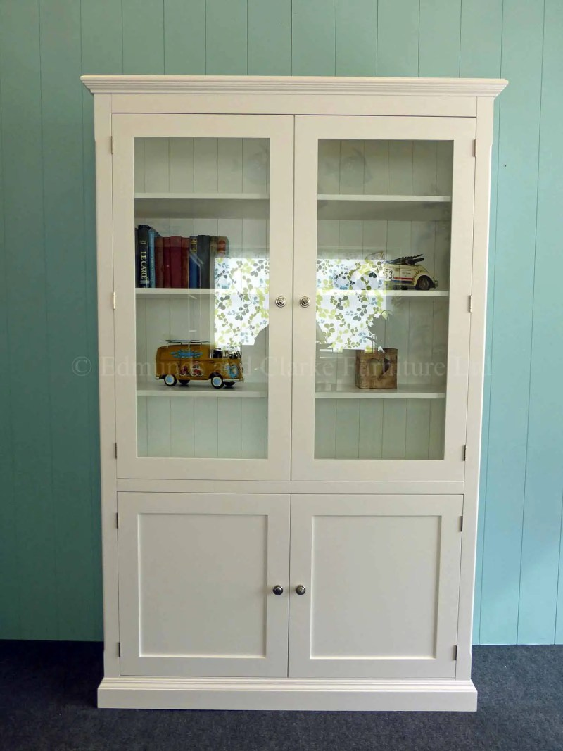 Painted white glazed paneled bookcase, two glazed doors above with two paneled doors below all shelves adjustable