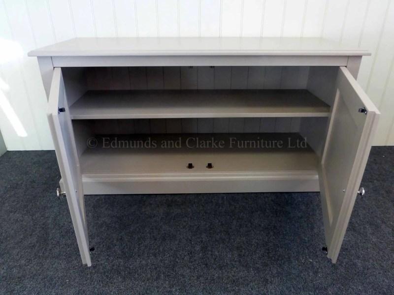 Painted low two door cupboard, one internal adjustable shelf