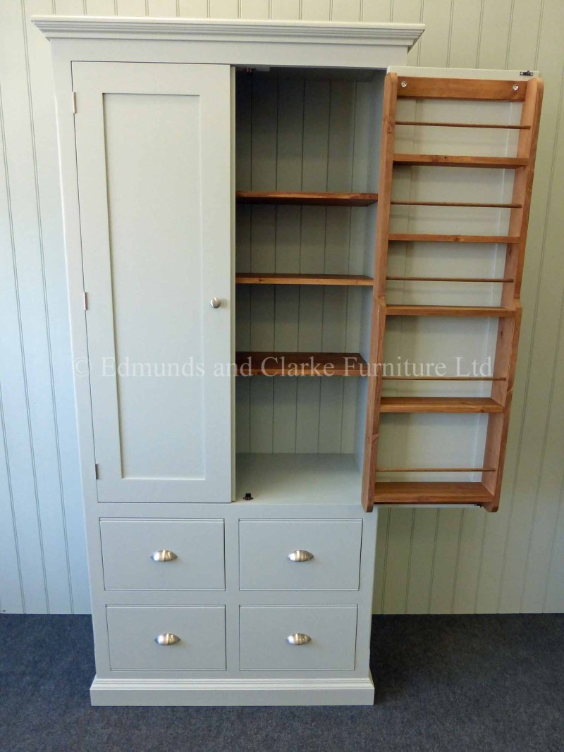 Painted larder cupboard with spice racks