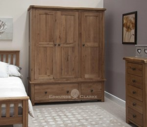 Lavenham solid rustic oak dark large triple wardrobe. with 2 drawers rustic handles, dovetailed joints dark rustic oak