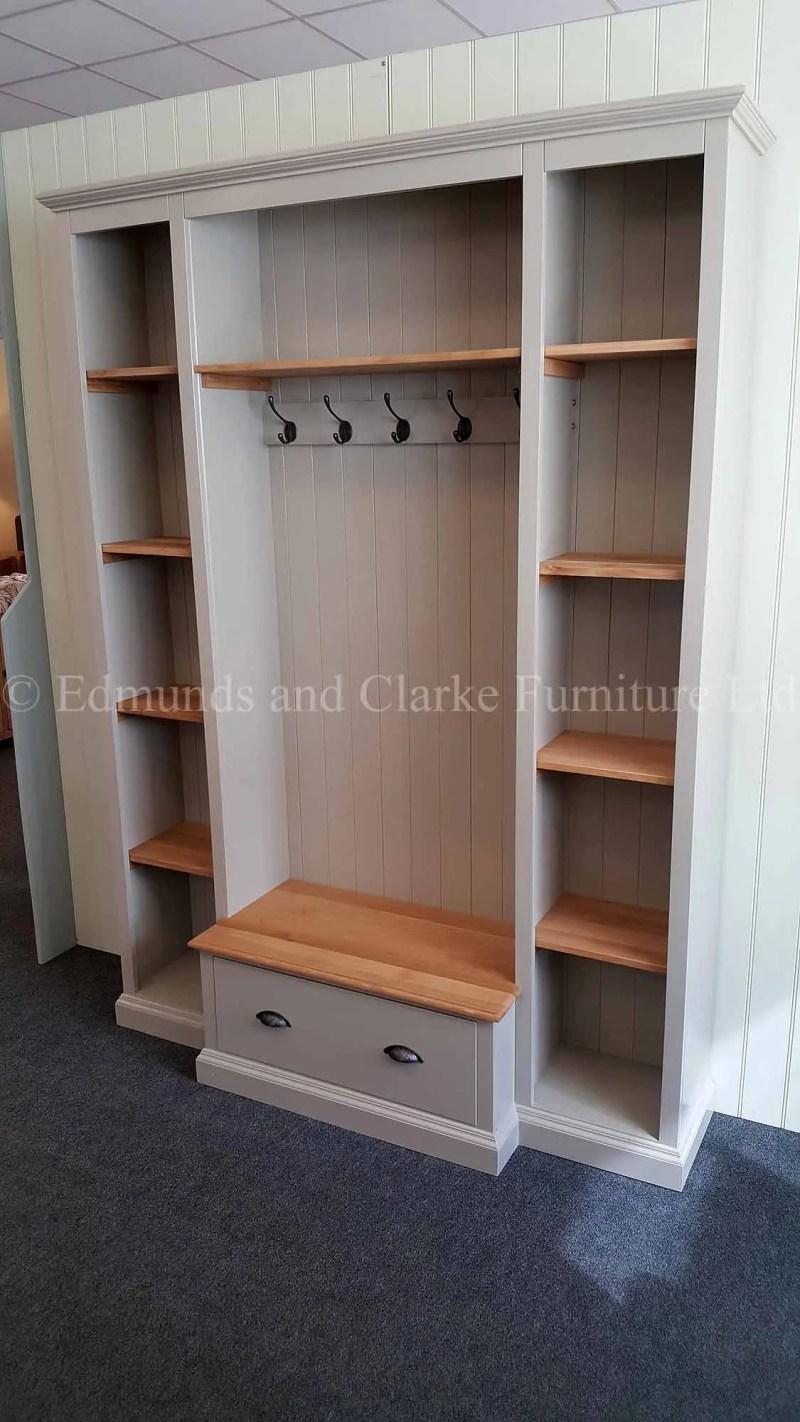 Bespoke hallway coat rack and shoe storage painted with oak shelves