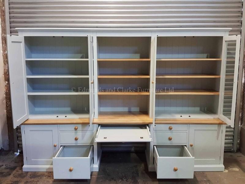 Custom made office workstation, foolscap filing drawers file shelving behind glazed doors