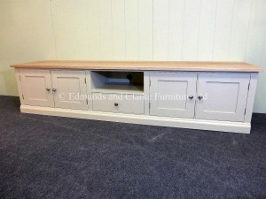 Bespoke Tv Entertainment Unit. painted in customer own colour similar to our dunwich stone. oak top and 4 door and one centre drawer