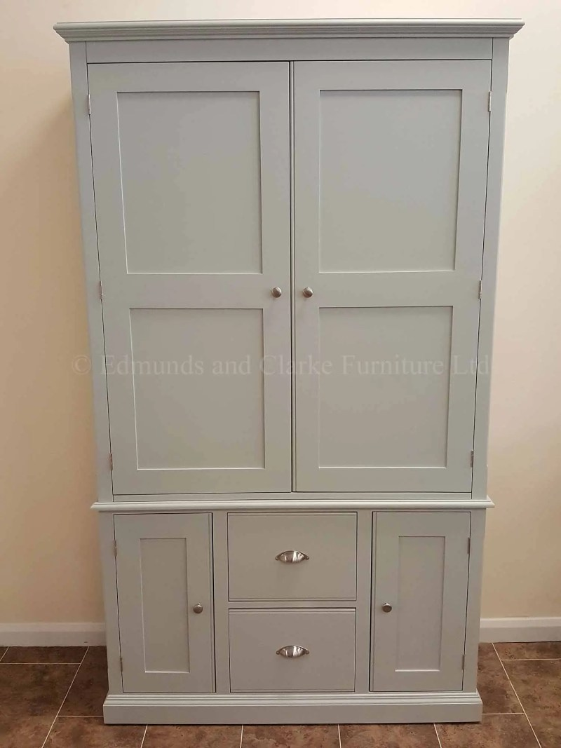 Wide two door painted larder cupboard, two large pan drawers below with door either side, made in two parts