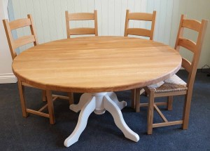 edmunds round dining table. oak top with painted pedestal legs. 5ft round would sit 4 to 6 people comfortably. 10 paint colours available .many other options available only here at edmunds & clarke