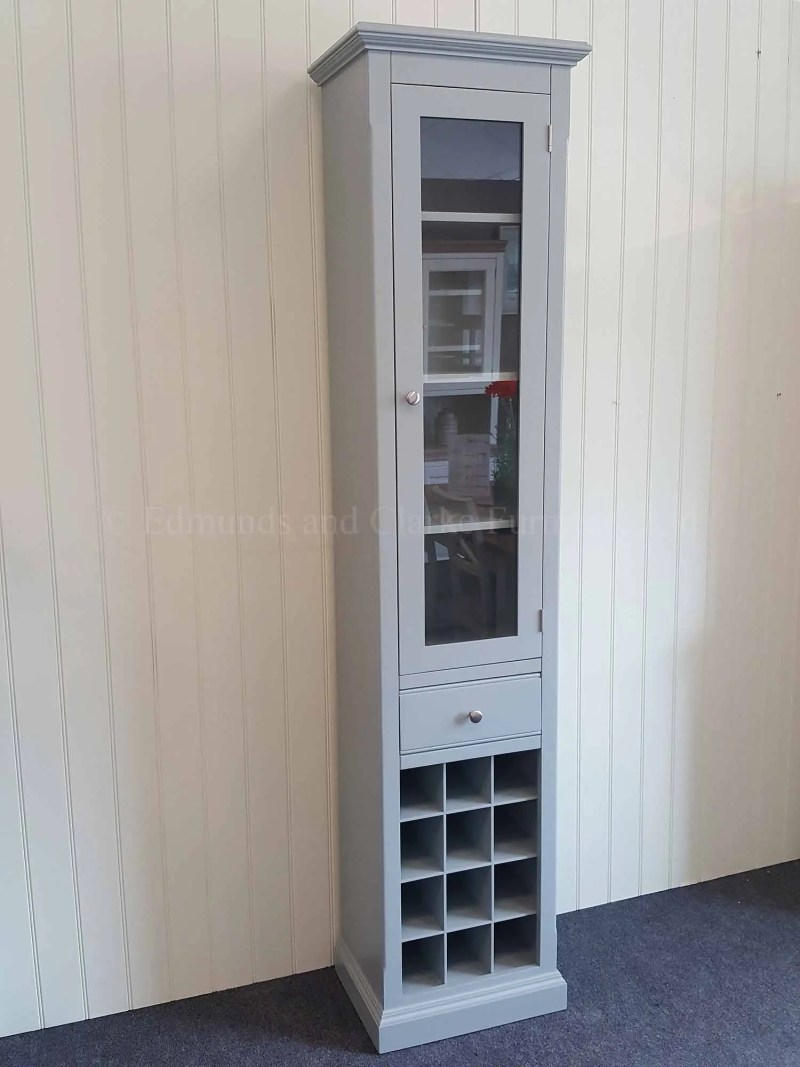 Tall narrow glazed cupboard three adjustable shelves drawer underneath with 12 bottle wine rack below painted all over in a choice of colours