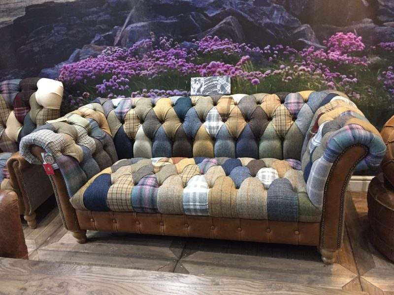 Vintage Sofa Co Chester Club Harlequin Fast Track Sofa in patchwork harris tweed and wool fabric with cerato brown leather arms and detailing on turned oak legs in showroom