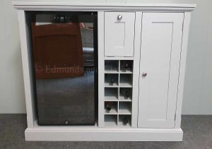drinks sideboard painted grey all over, wine cooler on left central wine rack holding 10 bottles with glass storage above, cupboard with 2 shelves on right