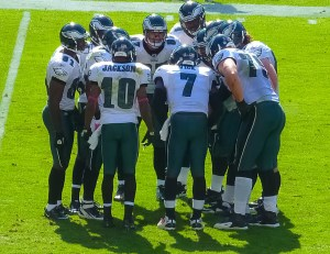 Desean Jackson (number 10) in a team huddle. Photo by Matthew Straubmuller Used under Creative Commons License