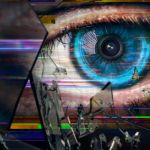 an eye behind a shattered screen