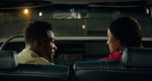 A man and a woman in a car talking