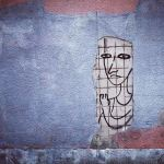 Sketch of person imprisoned on a wall