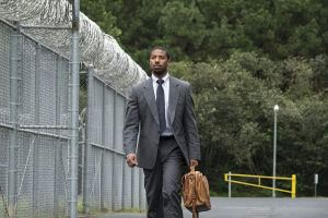 Michael B. Jordan walking outside of a jail
