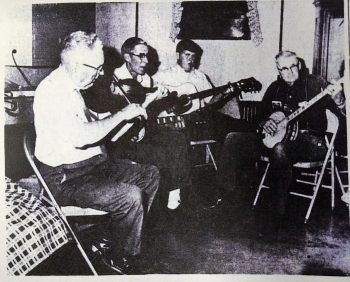 left to right: John Garman (fiddle), Tuck Garman (Guitar), and far right playing the banjo is Leo Garman. The 4th member of the Garman band was Claude Garman who also played the banjo but was absent when this picture was taken. In this picture 3rd from the left playing the guitar is Bobby All