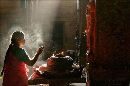 A woman praying to Hanuman in the Meenakshi Temple at Madurai