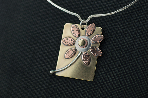 Mixed metal flower pendant on hand forged sterling silver neck wire
