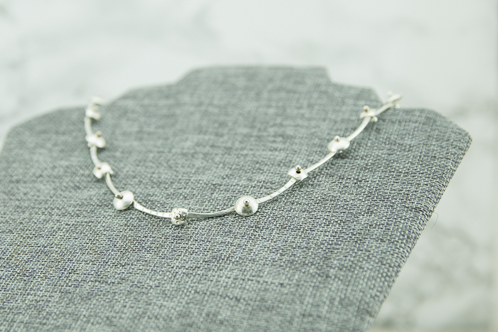 Sterling silver ball riveted metalwork necklace with round and square connectors