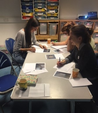 Project participants work at a table