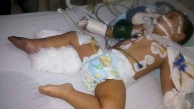 """صورة مواطن سوداني يطالب بفتوى """"القتل """" لإنهاء حياة طفله بعد أن عجز عن علاجه"""