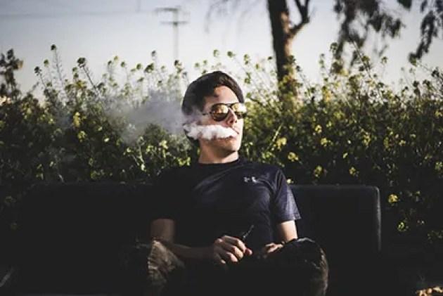Man Vaping in Park -ecigarettenews.net