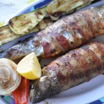Bacon-wrapped stuffed grilled trout