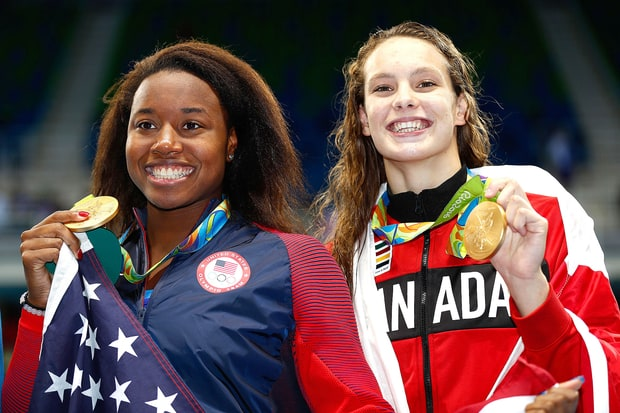 Simone Manuel from the US and Penny Oleksiak from Canada share the Olympic gold in the 100 meter freestyle