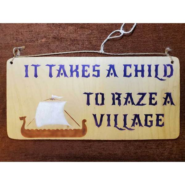 """""""It takes a child to raze a village"""" sign by Eclectics Creations"""