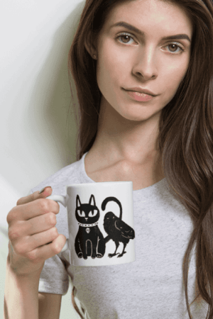 Gothic Cat and Crow Coven coffee mug for gothic girls and witchy people. This cute but creepy design will definitely catch some eyes. Show off your dark style with this pagan art. Witch fashion, pagan fashion, gothic fashion, goth fashion, wicca fashion, occult shirt, witch shirt, pagan shirt, gothic shirt, goth shirt, wicca shirt, witch home decor. #witch #witchcraft #gothic #cat #crow #raven