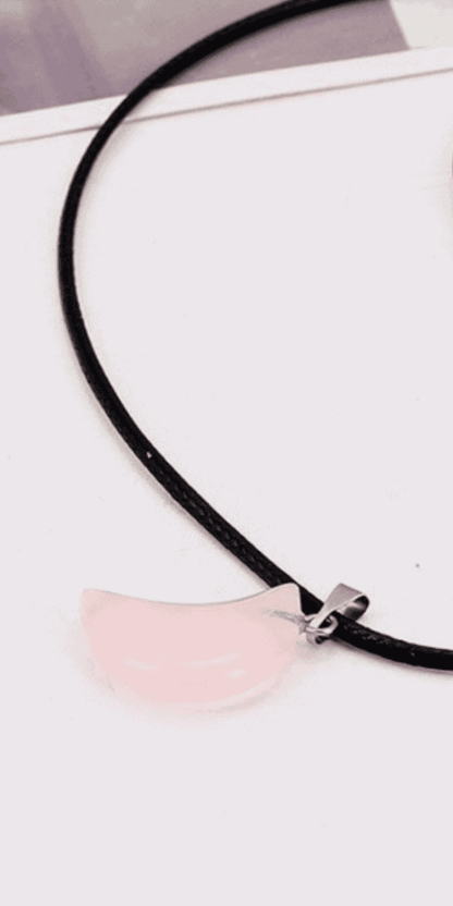 Rose Quartz Moon On Black Leather Cord: Use this rose quartz moon to draw in the epic power of the moon to enhance the love in all of your relationships. This moon charm will rest against your chest and send power to your heart chakra every moment of every day. The rose quartz crystal will heal broken hearts and creates an aura of self love around the wearer. This is the perfect gift for young women who may be going through times of uncertainty. #witchcraft #witch #magick #pagan #wicca #occult