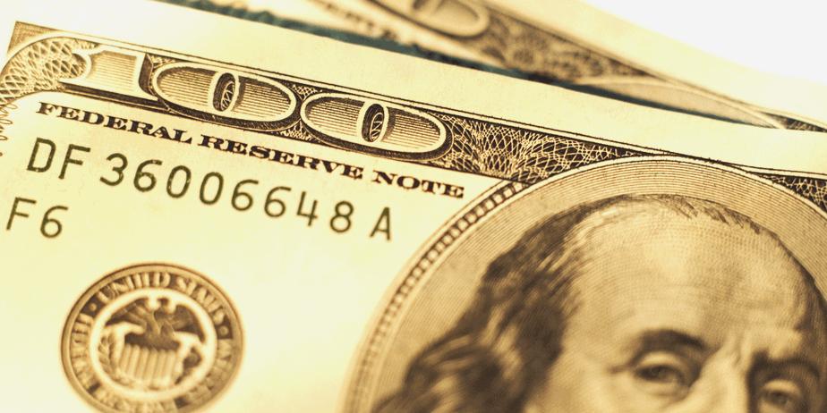 A close up of the corner of 100 dollar bills to represent abundant wealth